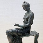 Bronze Image of a woman reading