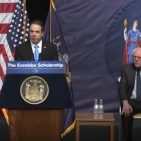 NY Governor Andrew Cuomo speaking in Queens while Senator Bernie Sanders is seated January 3, 2017 Photo: Screenshot/Official video on YouTube