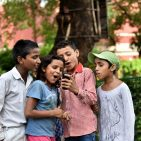 Children at St. Columba's School, Delhi, India, use a mobile phone Photo: Ashutosh Sharma/UNICEF