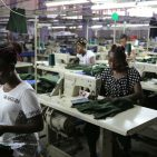 World Bank/Dominic Chavez Young factory workers producing shirts in Accra, Ghana.